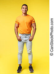 poches, coup, blanc, appareil photo, plein-longueur, désinvolte, vertical, studio, mascular, sourire, prise, jeune, hipster, confiant, corps, content, t-shirt, mains, pantalon, orange, type, pose, debout