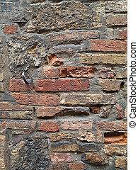 pocked brick wall