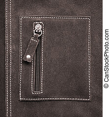 Pocket on brown leather texture as background
