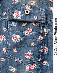 pocket on jeans shirt with flower pattern.