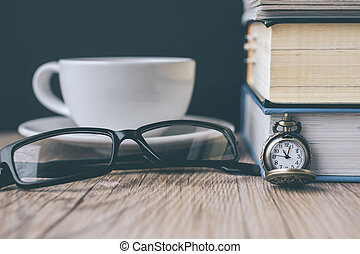 Pocket Watch and Coffee Cup with Book and The Glasses on Wooden in Vintage Tone