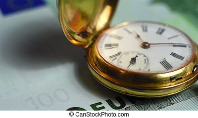 pocket watch and euro banknote - gold pocket watch and euro...
