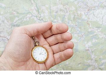 pocket watch in male hand