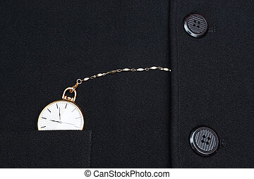 Pocket watch on a chain hidden in the jacket businessman.