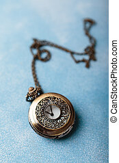 Pocket watch on blue background