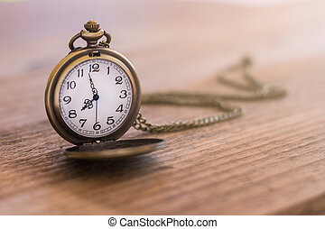 pocket watch on the old wooden table with copy space, concept time and work