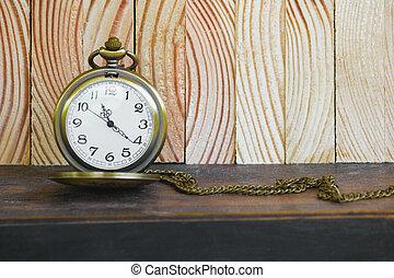 Pocket Watch On Vintage Wood