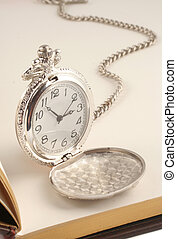 pocket watch - antique silver pocket watch on top of blank...