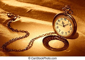 Pocket Watch - Time concept. Vintage pocket watch on sand