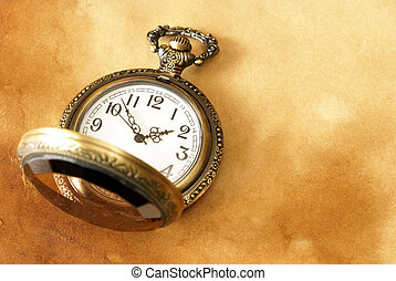 Pocket Watch - A macro shot of a pocket watch on some aged...
