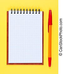 Pocketbook and ballpoint pen on yellow background.