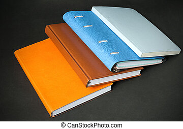 pocketbook - notebook diary on black background