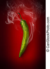 hot green pepper on a red background - pod is very hot green...