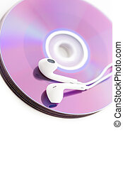 Podcasting - White headphones on top of CDs.