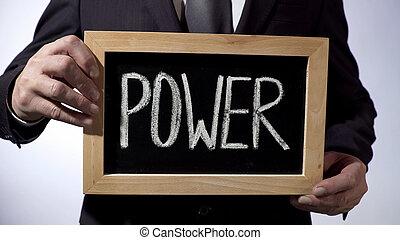 poder, escrito, ligado, quadro-negro, homem negócios, segurando, sinal, negócio, política