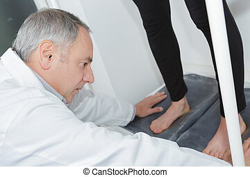 podiatrist working with foot