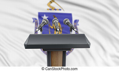 Podium lectern with microphones and Massachusetts flag in background