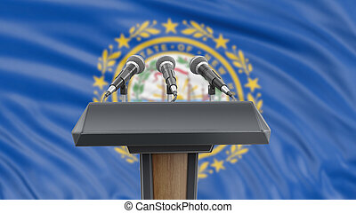 Podium lectern with microphones and New Hampshire flag in background