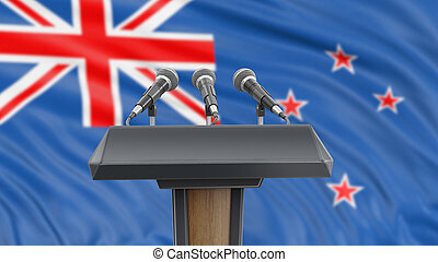 Podium lectern with microphones and New Zealand flag in background