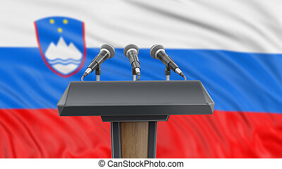 Podium lectern with microphones and Slovene Flag in ...