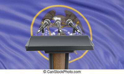 Podium lectern with microphones and Utah flag in background
