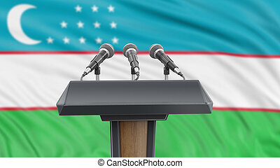 Podium lectern with microphones and Uzbekistan flag in background
