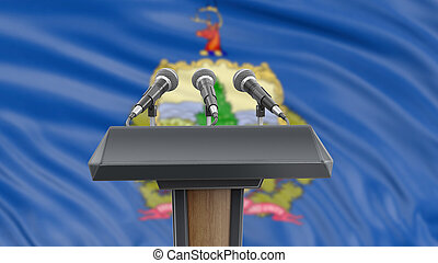 Podium lectern with microphones and Vermont flag in background