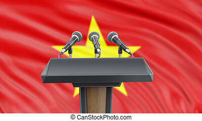 Podium lectern with microphones and Vietnamese Flag in background