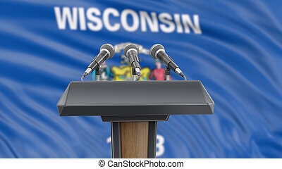 Podium lectern with microphones and Wisconsin flag in background