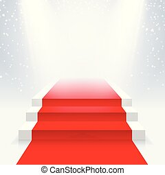 Podium with a red carpet in the illumination of the beams of searchlights.
