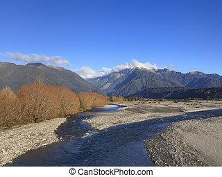 Poerua River and the Southern Alps, West Coast, South Island, New Zealand.