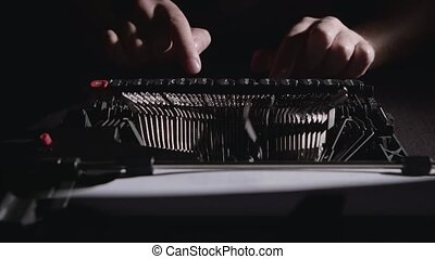 Poet types the text of the poem on a retro typewriter