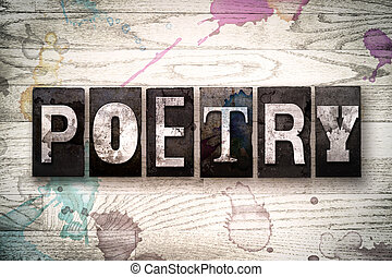 """The word """"POETRY"""" written in vintage, dirty metal letterpress type on a whitewashed wooden background with ink and paint stains."""