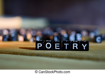 POETRY concept wooden blocks on the table.