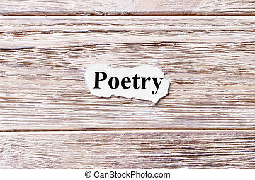 poetry of the word on paper. concept. Words of poetry on a wooden background