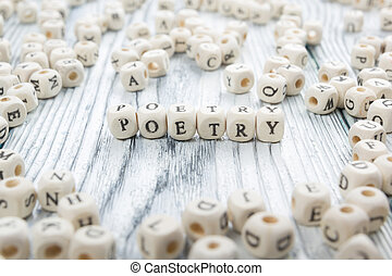 Poetry word written on wood block. wooden abc.