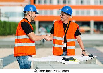 poignée main, site construction