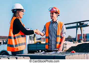 poignée main, site construction, professionnels