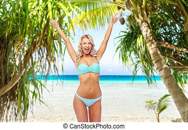 poing, jeune, pompe, bikini, femme heureuse