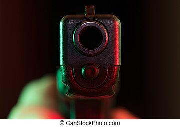 Point blank gun - Pistol gun pointed at the viewer's face