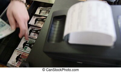 Point of sale - cashier gives change and a receipt