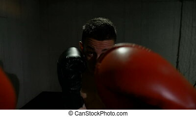 Point of view boxer punching partner in training at gym studio preparing for championship