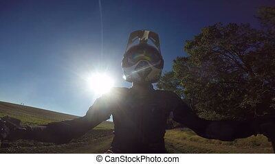 Point of View: Enduro rider in motorcycle protective gear...