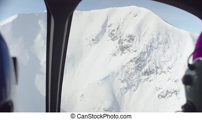 Point of view from pilot of a helicopter flying over the...