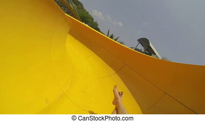 Fun on the water slide in aqua park - Point of view Fun on...