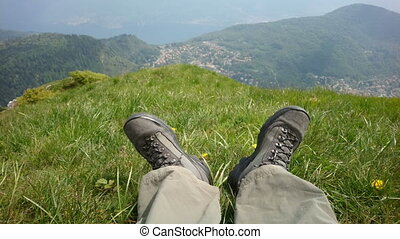 Point of view of a hiker resting after long trail on the...