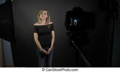Point of view of cameraman shooting young attractive woman...