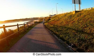 Point of view of skateboarder cruising down on pedestrian...