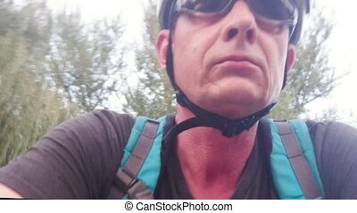 Point of view on cyclist. Rider's head and shoulders.
