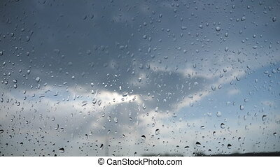 Point of view through the windshield of car with raindrops...